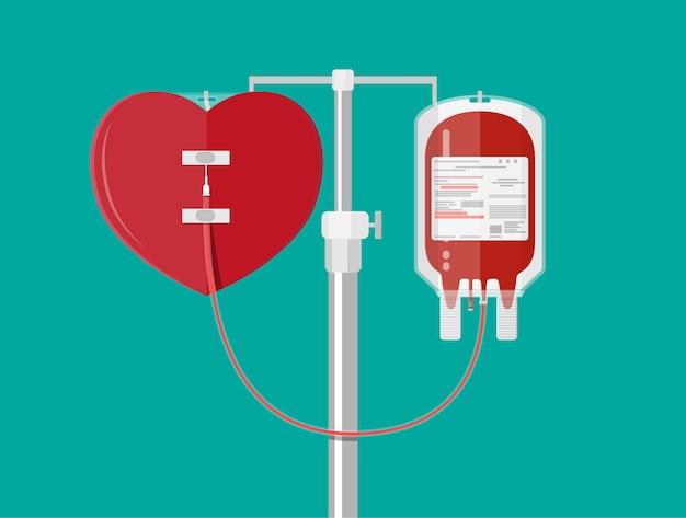 Bolsa de sangre y corazón en el soporte
