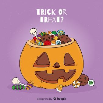 Bolso de calabaza de halloween dibujado a mano y dulces