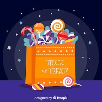Bolso de caramelos de halloween con diseño plano