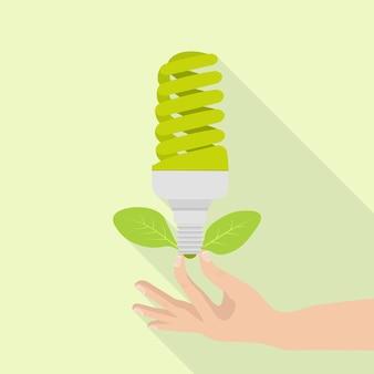 Bombilla de ecología en la mano humana como ilustración del concepto de energía verde