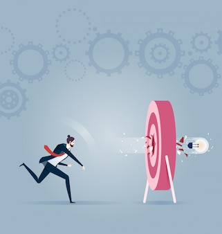 Bombilla de luz de tiro de empresario en objetivo. vector de concepto