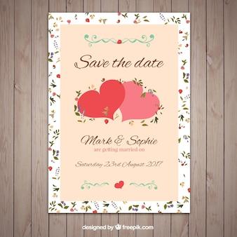 Bonita invitación de boda con dos lindos corazones