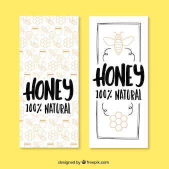 Bonitos banners de miel dibujados a mano
