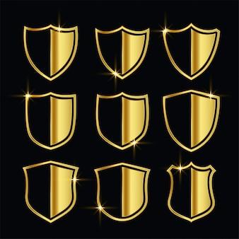 Bonitos símbolos de seguridad dorados o conjunto de escudo