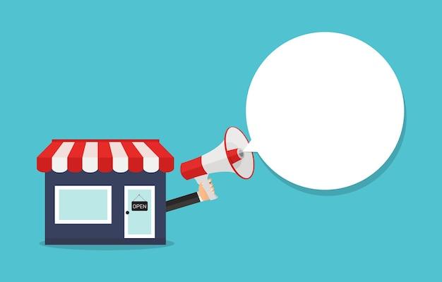 Boquilla para pequeñas empresas. tienda y mano con concepto de megáfono.