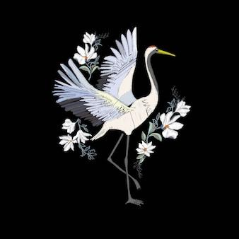 Bordado con pájaro grulla