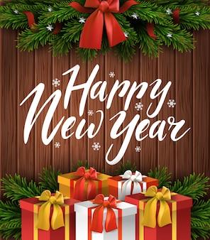 Borde del árbol de navidad con arco y regalos sobre fondo de madera.