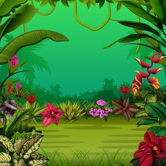 Bosque exótico con los árboles y las flores.