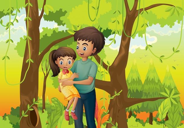 Un bosque con un padre cargando a su hija.
