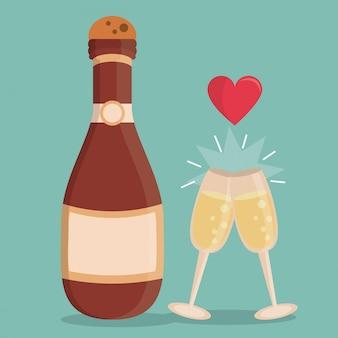 Botella de champán y copas de champán con corazón
