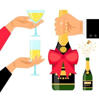 Botella de champán y copas en las manos.