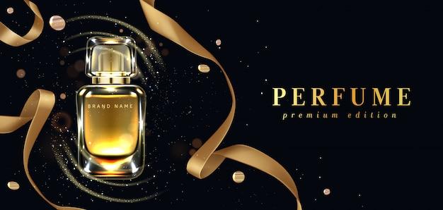 Botella de perfume y cinta dorada sobre negro
