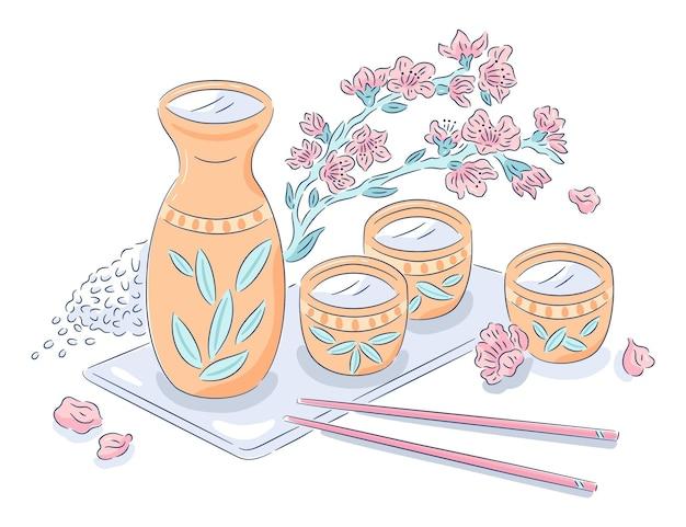Botella de sake con tazas