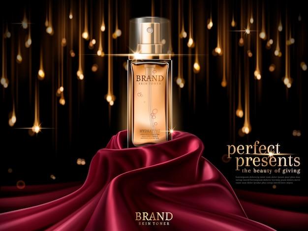 Botella de vidrio de lujo o perfume en satén escarlata aislado sobre fondo de bombilla bokeh