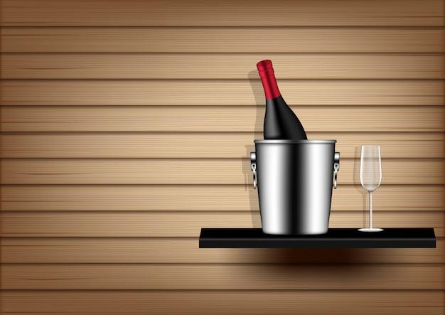 Botella de vino, cubo de hielo y vidrio