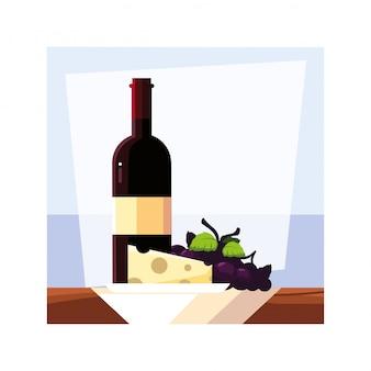 Botella de vino con queso y uvas.