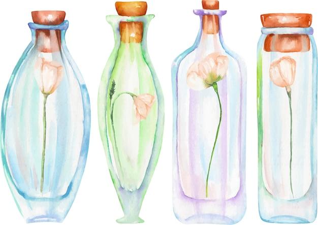 Botellas de acuarela con flores tiernas en el interior.