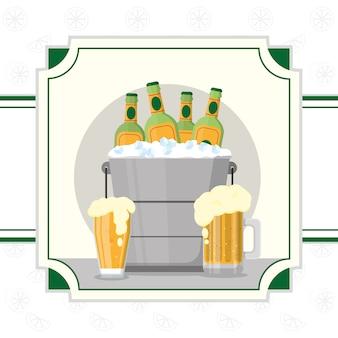 Botellas de cerveza en el cubo de hielo