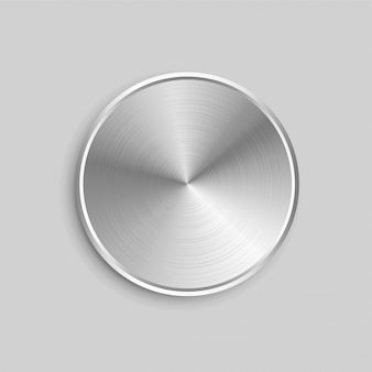 Botón circular de metal realista con superficie de acero cepillado.