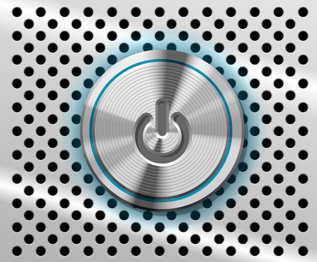 El botón de encendido resaltado sobre fondo de metal perforado