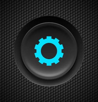 Botón negro con signo de configuración azul sobre fondo de carbono.