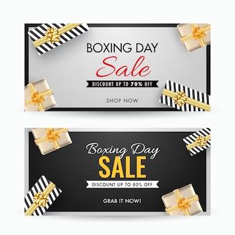 Boxing day sale banner con diferentes ofertas de descuento y vista superior de cajas de regalo decoradas en gris y negro
