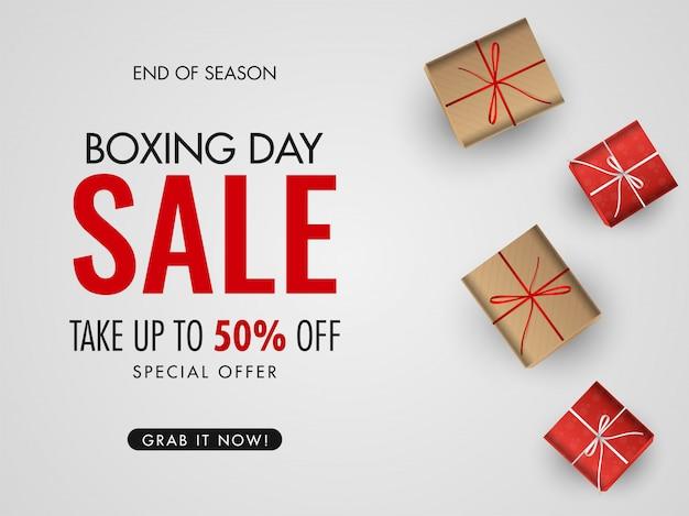 Boxing day sale poster o banner con oferta de 50% de descuento y vista superior de cajas de regalo en blanco