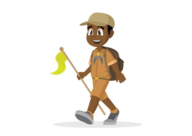 Boy scout africano caminando.