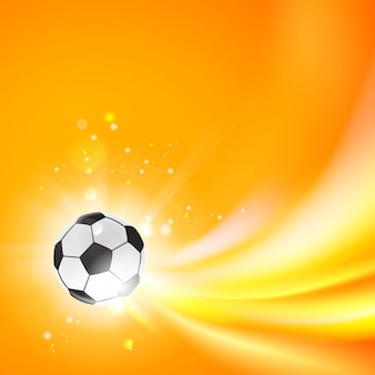 Brillante balón de fútbol sobre un fondo naranja