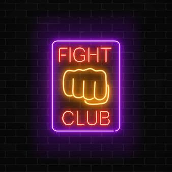 Brillante letrero de neón del club de lucha en el marco rectangular en la pared de ladrillo oscuro letrero de neón del club de boxeo.