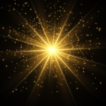 Brillantes estrellas doradas aisladas en negro. efectos, deslumbramiento, líneas, purpurina, explosión, luz dorada.