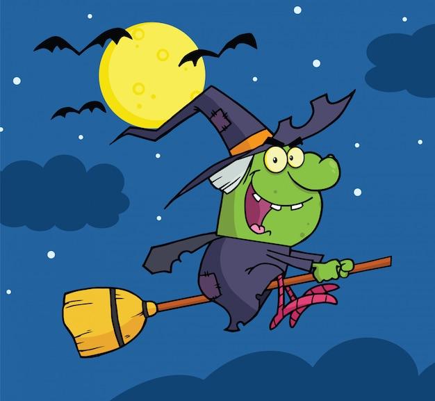 Bruja monta un palo de escoba en la noche