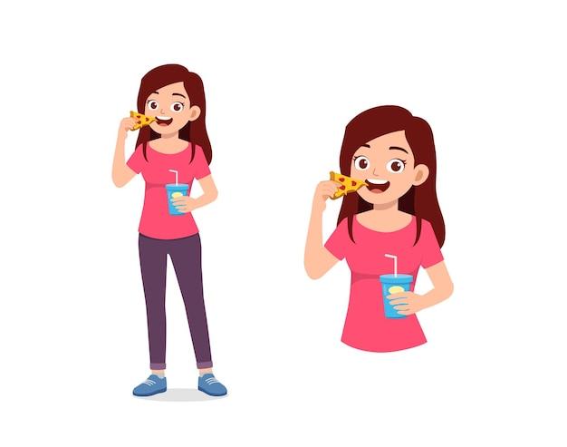 Buena mujer joven comer comida rápida poco saludable