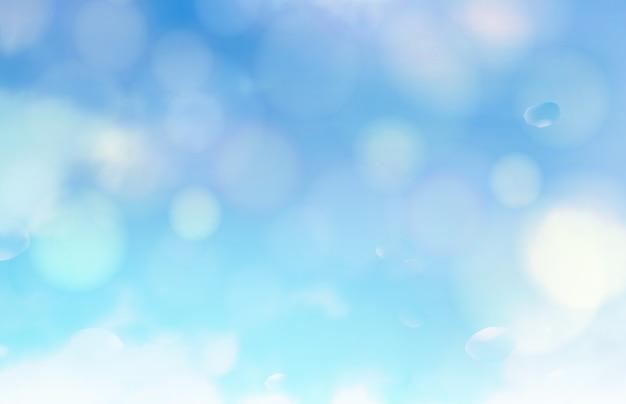 Las burbujas de bokeh y el sol parpadean sobre fondo azul.