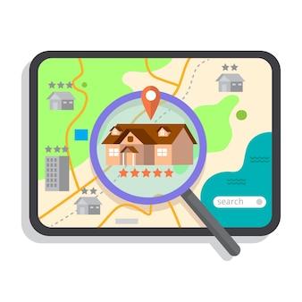 Búsqueda de bienes raíces con tableta y lupa