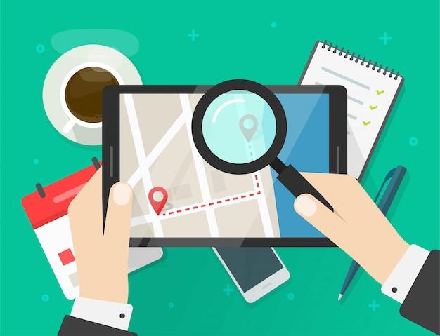 Búsqueda de la ubicación del mapa de carreteras o revisión de la ruta de la dirección del viaje en una tableta digital de navegación de la ciudad