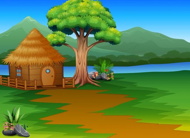 Cabaña de bosque de dibujos animados por el río con fondo de paisaje de montañas