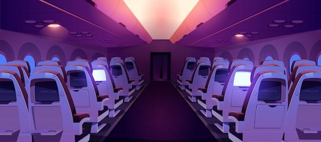 Cabina de avión con asientos y pantallas dentro de la vista