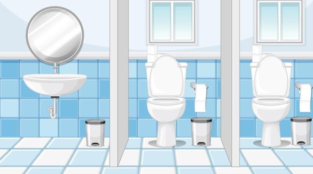 Cabinas de baños públicos con lavabo y espejo.