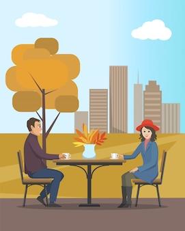 Café en parque de la ciudad de otoño gente enamorada