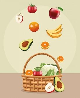 Caída de frutas en la cesta con cultivo de hortalizas