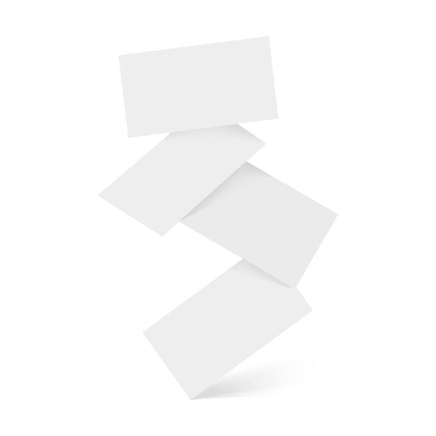 Caída de tarjetas de visita blancas en blanco.