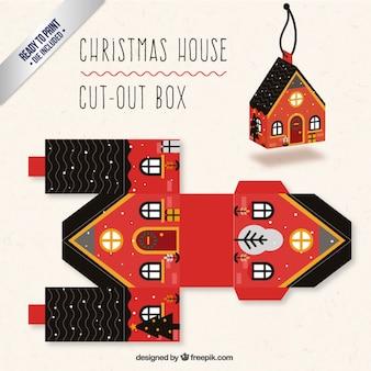 Caja de casa navideña en colores rojo y negro