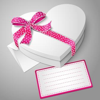 Caja realista en forma de corazón blanco en blanco con cinta, nudo de lazo