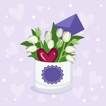 Caja redonda con una pegatina para texto con corazones y sobres de tulipanes rojos, amarillos, blancos, rosas