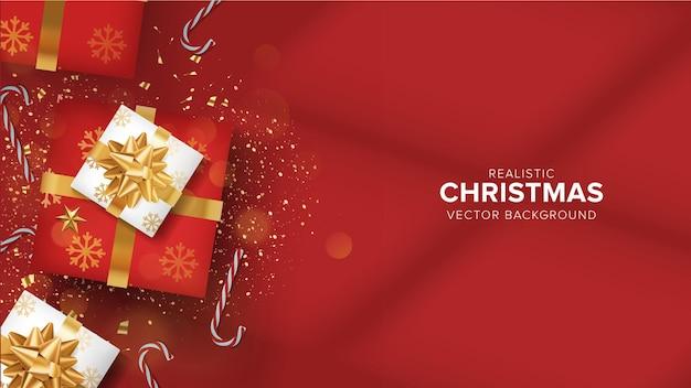 Caja de regalo 3d de navidad flatlay realista sobre fondo rojo vector premium
