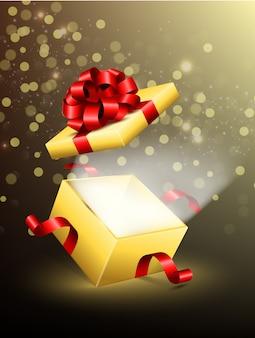 Caja de regalo abierta con brillantes rayos de luz.
