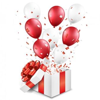 Caja de regalo abierta sorpresa con globos y confeti