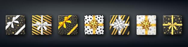 Caja de regalo en blanco y negro con cinta plateada y dorada y lazo, vista superior. navidad, fiesta de año nuevo, diseño de paquete de feliz cumpleaños. regalo. vector.