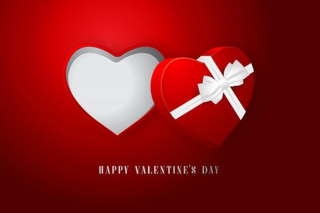 Caja de regalo de corazón para el día de san valentín sobre fondo rojo.